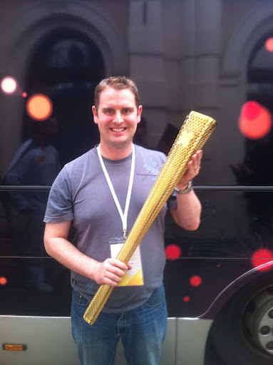 Adrian with an Olympic Torch